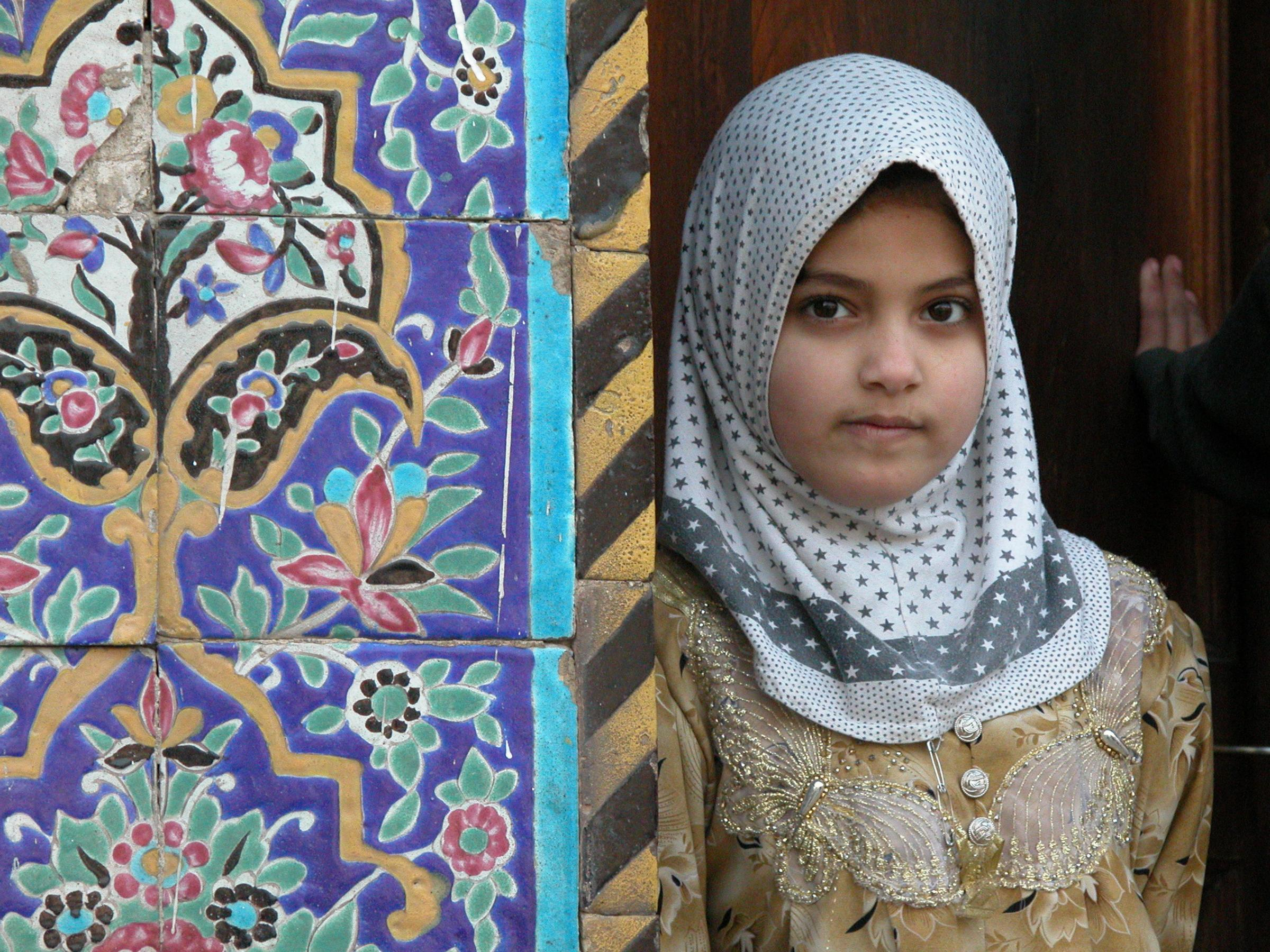 Iraqi Girl Leaning Against Wall