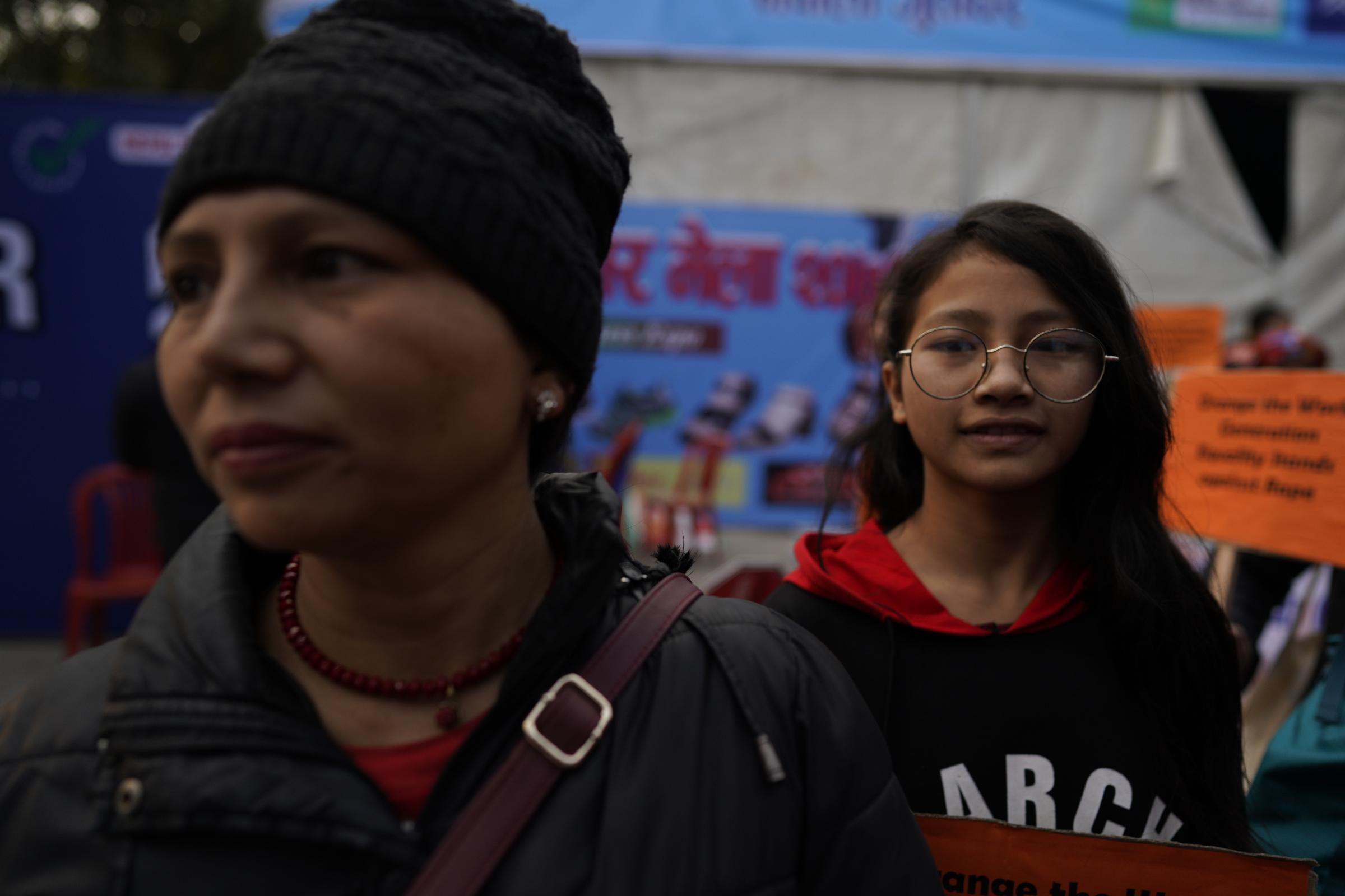 A woman and young girl walk together during a rally.