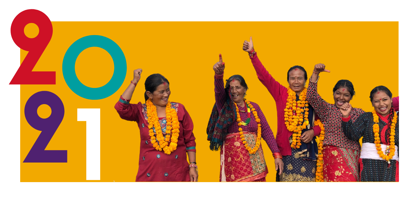 "Yellow and white colorblock graphic. Multicolor ""2021"" text sits on the left-side of a cut-out image of Nepali women smiling and celebrating."