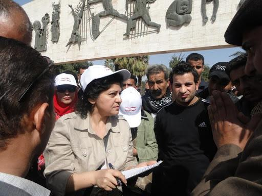 Woman organizer within a crowd