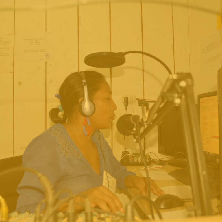 Woman speaking into the microphone during a radio broadcast