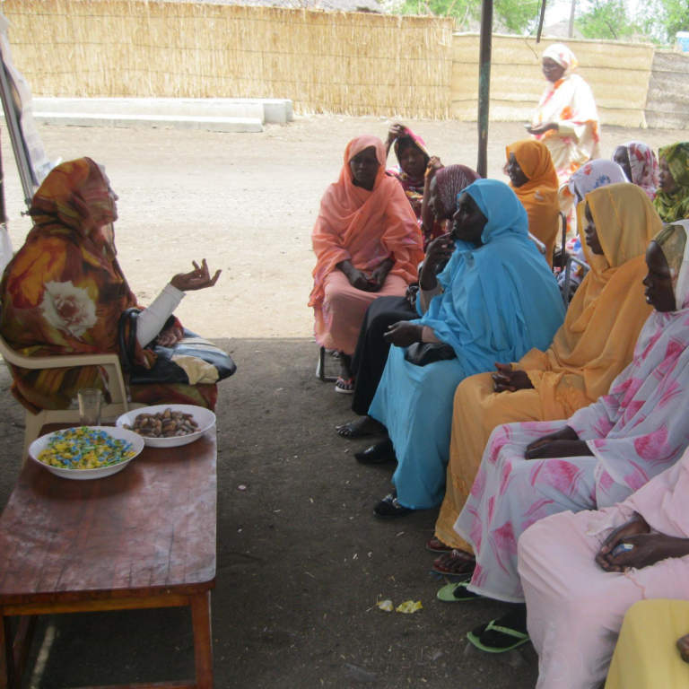 Women gather together for a community workshop.