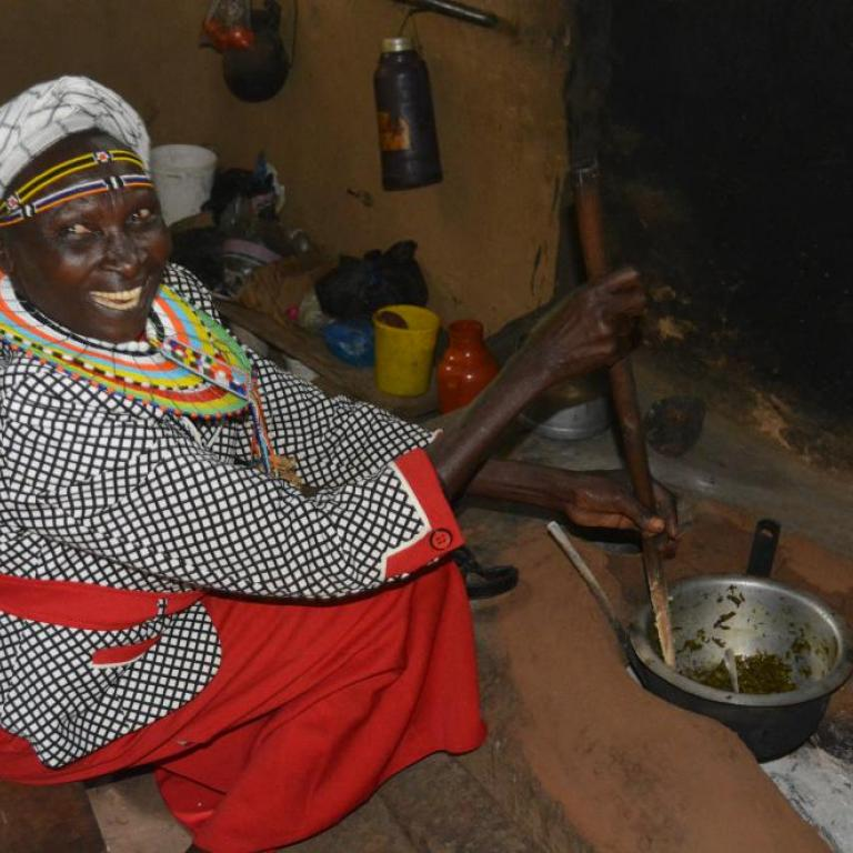 Christine cooking over a jiko stove