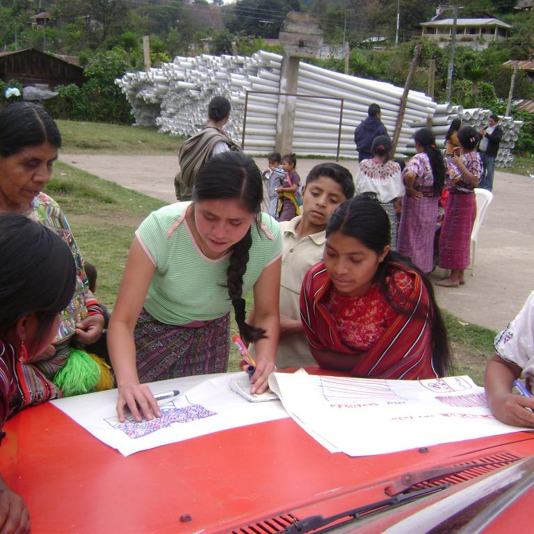 Girls in Guatemala gather to complete a project
