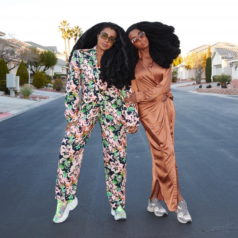 TK & Cipriana pose together in the center of a street