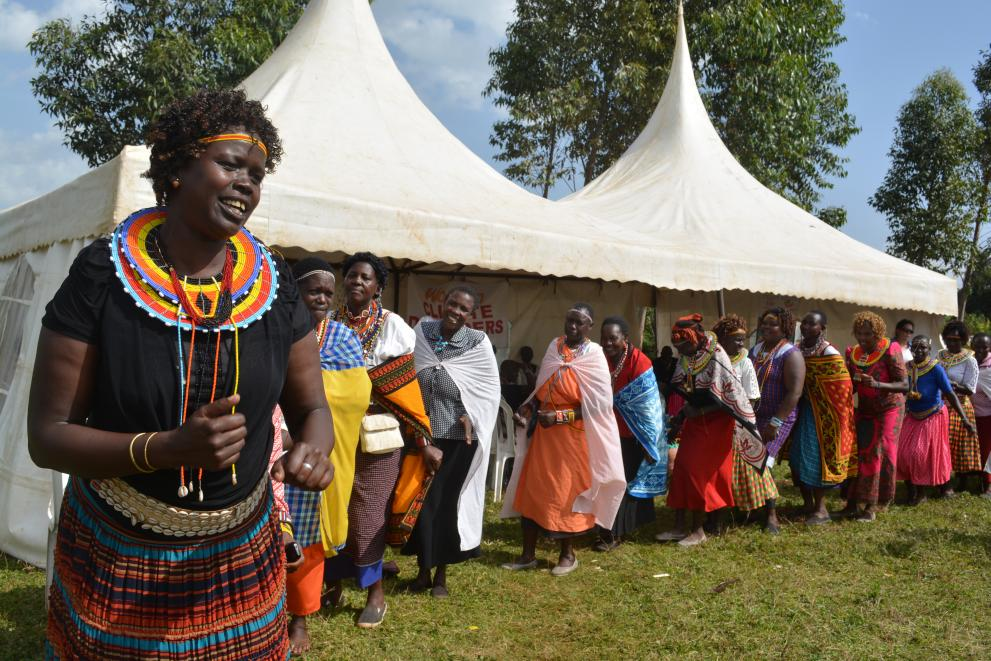 Women dance together at a MADRE-organized exchange.