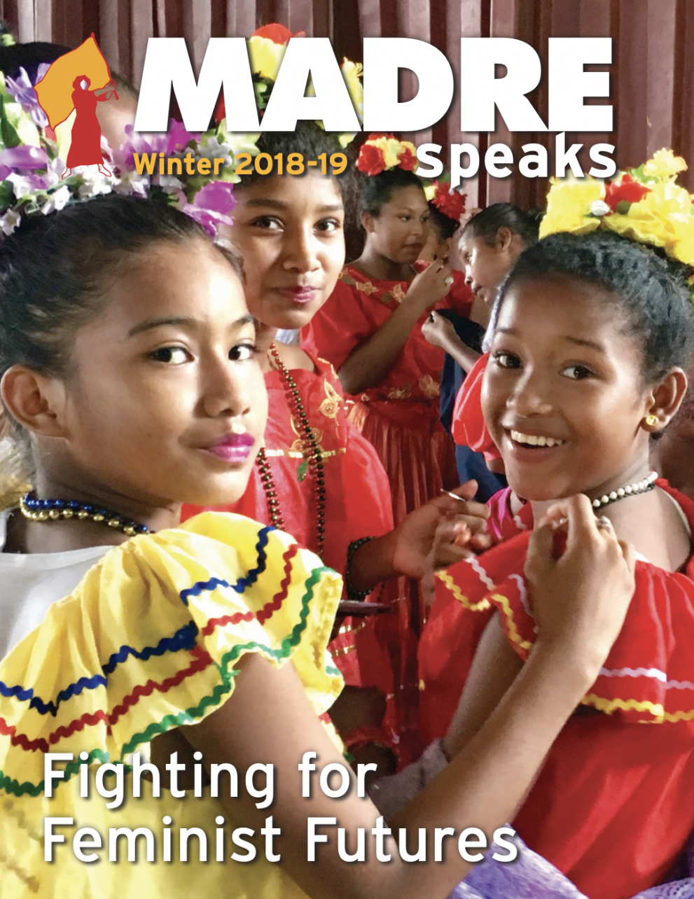 MADREspeaks Winter 2018-2019 Newsletter Cover. Young girls in traditional costume post for the camera after a performance.