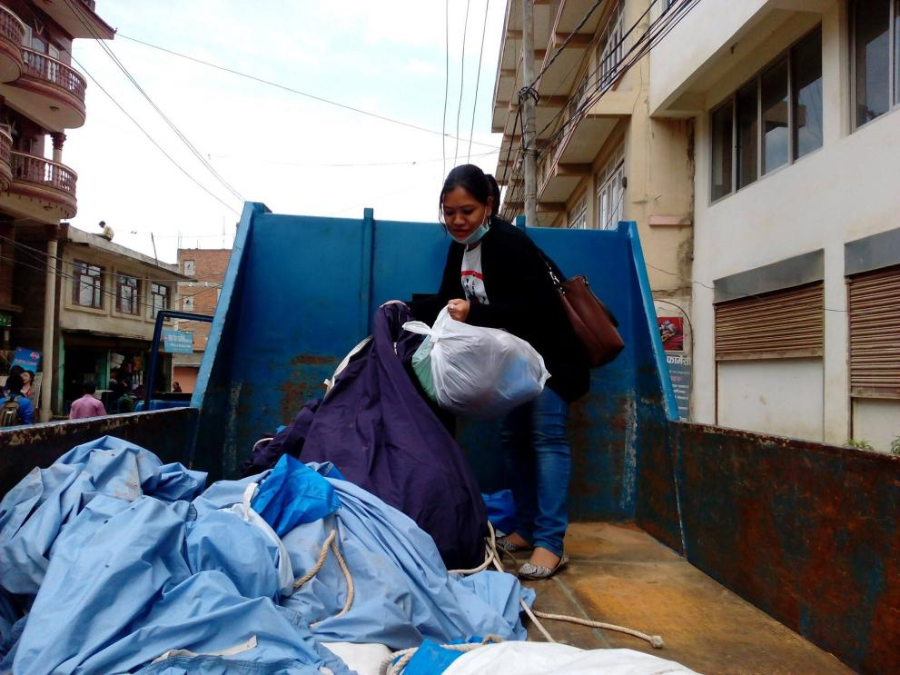 Women in Nepal distributing health kits in the earthquake aftermath