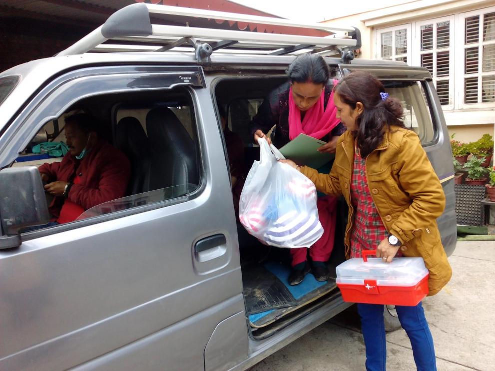 Women in Nepal distribute health kits in the aftermath of the earthquake