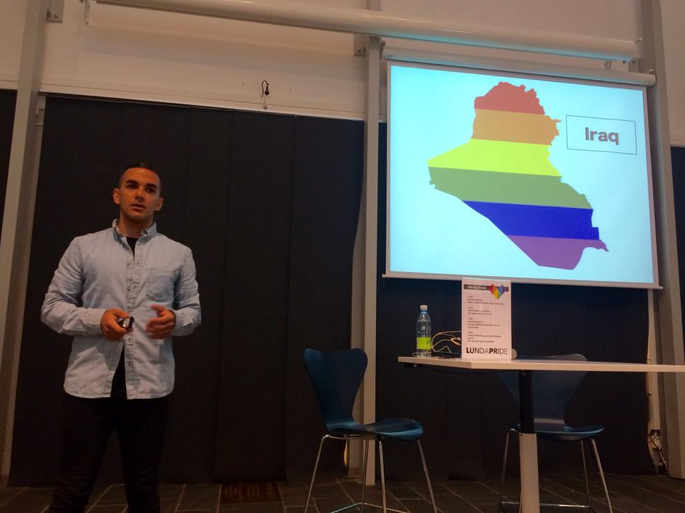 Amir Ashour, MADRE's Iraq Human Rights Consultant, presenting during a Pride event in Lund, Sweden