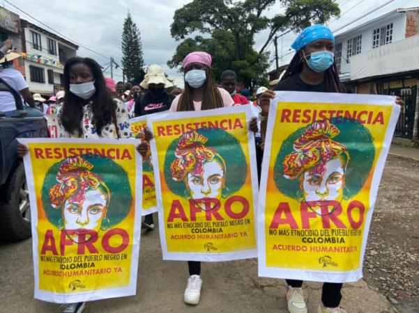 """Members of Proceso de Comunidades Negras Gather in Protest holding signs that read """"Afro Resistencia"""""""